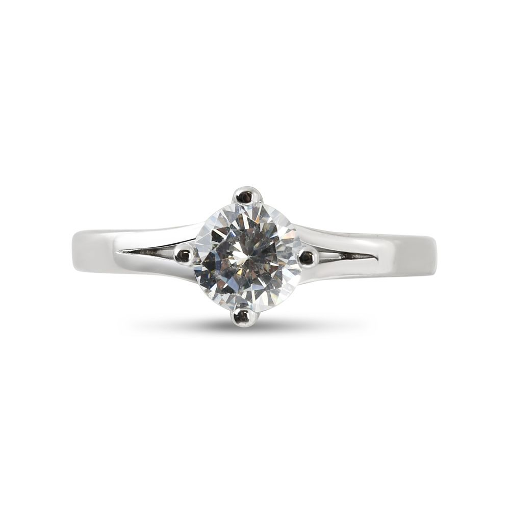 Four Claw North East West South Round Diamond Engagement Ring