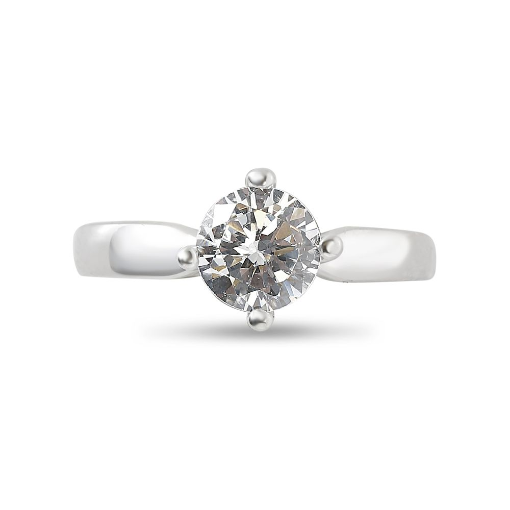 Four Claw Solitaire North East South West Engagement Ring