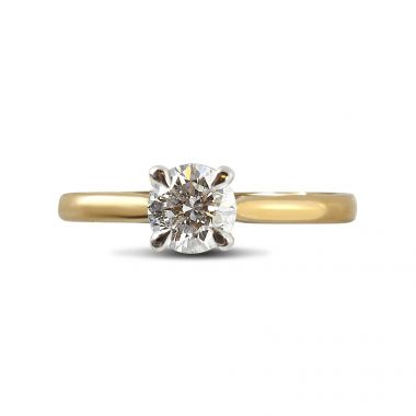Four claw 18kt Yellow band and Platinum prongs diamond engagement ring top view
