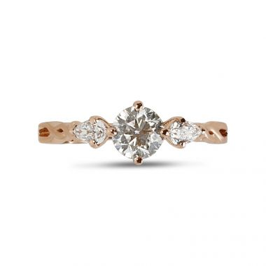 Rose gold round and pear shapes diamond ring top view